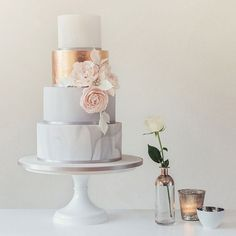 Wedding Cakes & Chocolates by Poppy Pickering. Beautiful bespoke cakes. Gold, pink and white. With pink rose detail. #modernweddingcakes