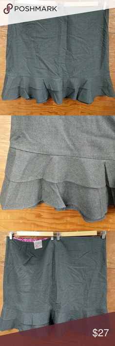 Torrid Gray ruffled pencil skirt Size 26 NWT First off, let me apologize for the wrinkles, I've had my items lovingly stored in a bin and my steamer is broken!  Dark gray pencil skirt with side zipper and two matching ruffles at the bottom. Size 26, NWT. Third photo is of the back. torrid Skirts Pencil