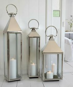 California Style......I love these lanterns.....buy the flameless real wax candles.....put them on the porch....winter  summer.....