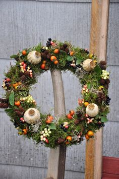 moss cones and fruit wreath
