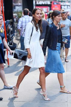 Alicia Vikander is a red carpet style star. See all her best outfits, like the above white dress, on wmag.com.