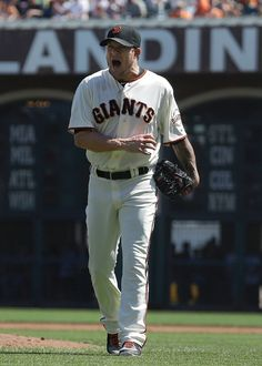 San Francisco Giants pitcher Jake Peavy yells after Arizona Diamondbacks' Chris Owings hit into a double play to end the top of the third inning of a baseball game in San Francisco, Thursday, Sept. 11, 2014. (AP Photo/Jeff Chiu)