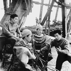 1973 Construction workers discuss repairs of the bombed out Ham Rong Bridge, in central North Vietnam.