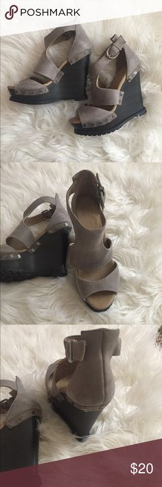 Jessica Simpson wedges Worn one time. In excellent condition I just never wear them. I wore them in a airport ( I know ridiculous ) but they were SO comfortable to walk in. They are gray leather with dark gray heel Jessica Simpson Shoes