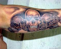 3 skull arm tattoo