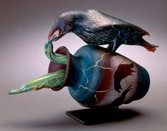 "Crow with Pods, 1998 blown glass with steel stand  13""h x 18""w x 7""d"