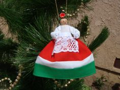 Hungary clothespin doll ORNAMENT, red, white, green dress White Tops, Red And White, Christmas Decorations, Christmas Ornaments, Holiday Decor, Metal Spring, Clothespin Dolls, Hungary, My Mom