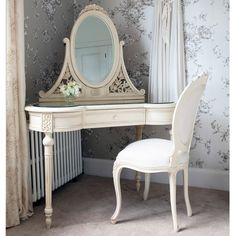 A lovely dressing table, with a bevelled glass top, adjustable bevelled mirror and three drawers. Exquisitely hand carved from mahogany, and hand finished in antique distressed cream.