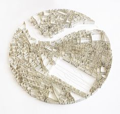 Matthew Picton makes sculptural maps of cities out of books about the respective city. Here, Dresden in 1945, made of Wagner's score for The Ring, 2010.