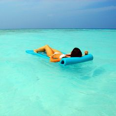 Luiza floating just off the #beach of the #Vabbinfaru #island, #Maldives. Built on an almost perfectly #roundisland, with its elegant #villas and #unpretentious #barefootluxury, #BanyanTreeVabbinfaru remains a favourite spot for #romantic #couples and #eco-aficionados. Photo by #Travel+#Style. Our #BanyanTree review: http://www.travelplusstyle.com/hotels/banyan-tree-vabbinfaru. ||| #vacation #holidays #sea #sun #blue #indianocean