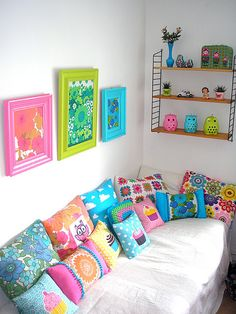 oooohhhhh. I love the vintage sheets in frames and on pillows.-love the pillows and the owls on the shelf