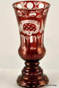 Frederich Egermann, glass designer (1777-1864) - The Egermann Bohemian glass vase is ruby red in color. The pattern is 'the bird and the castle' design with other baroque patterns etched in clear. It is gilded with 24 carats gold to get the final appearance and does not use lead as one might expect. $75.00