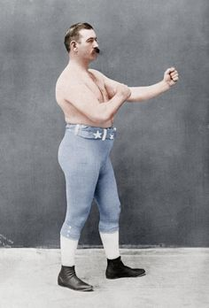 This is a photograph of John Sullivan, a prize fighter of the late He was one of the last heavyweight champions of bare-knuckle boxing. This photo was taken in was a popular sport among mostly male, working and middle-class citizens. Charlie Chaplin, Old Pictures, Old Photos, Vintage Photos, Bare Knuckle Boxing, Mma, But Football, Boxing Posters, Heavyweight Boxing