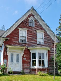 Maine Cottage- love the weathered red paint and third floor window's shape