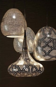 From the Dutch furniture company, Zenza, these silver punched metal pendant lights provide just the right amount of luster for any interior space. These pendants not only offer cool mood lighting, but also add visual interest and texture to a room. Interior Lighting, Home Lighting, Lighting Design, Pendant Lighting, Pendant Lamps, Pendants, Unique Lighting, Kitchen Lighting, Light Luz