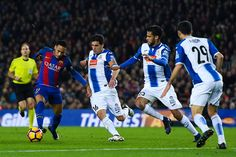 Neymar Jr. of FC Barcelona competes for the ball with RCD Espanyol players during the La Liga match between FC Barcelona and RCD Espanyol at the Camp Nou stadium on December 18, 2016 in Barcelona, Catalonia.