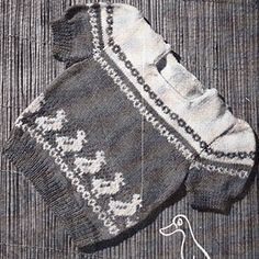 Goosie gander baby jumper or sweater with stranded geese across the front. Free knitting pattern.