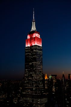 """July 12, 2016: In partnership with Sony Pictures and """"Ghostbusters,"""" the Empire State Building shines in red and white to honor Gilda's Club NYC and Gildafest 2016."""