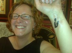 Flickr user infowidget also participated in Project Brand Yourself a Librarian by getting the classic library symbol tattooed on her inner wrist.
