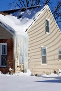 Icicles Hanging from an Ice Dam on House Eve - BanksPhotos/E+/Getty Images