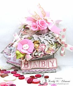"""Today I'm sharing a shabby chic Peek a Boo Baby Girl Shortie Tag Album Video Tour for the """"April Showers"""" challenge at the Frilly and Funkie Challenge Blog."""