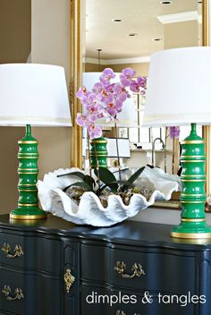 Large Clam Shell Bowl use as Planter. For many more Decor Ideas with these large (faux) Clams, go here: http://www.completely-coastal.com/2009/10/giant-clam-shells-everywhere.html