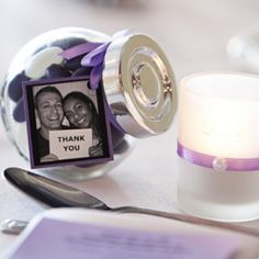 Glass jars filled with lollies to fit in colour theme. Attach to each jar a thank you tag featuring a photo of the couple holding a thank you plaque.