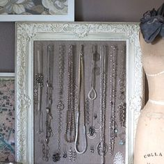 Make this jewelry display... Frame, linen and cup hooks. Brilliant!