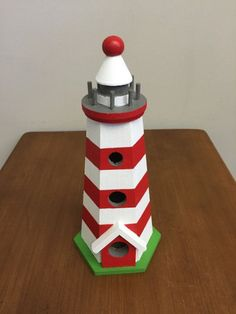 Decorative Birdhouse Lighthouse by OhBabyCake on Etsy Decorative Bird Houses, Bird Houses Painted, Painted Birdhouses, Birdhouse Craft, Birdhouse Ideas, Craft Show Booths, Spool Tables, Garden Crafts, Garden Projects
