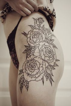 Floral Thigh Tattoo.