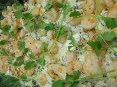 Grilled Red Fish with a cilantro cream sauce topped with bay shrimp and lump crabmeat