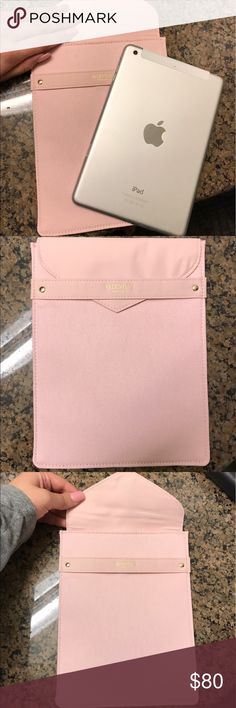 """NWT Valentino baby pink iPad mini sleeve Brand new Valentino iPad mini sleeve, comes in baby pink with gold detailing, this sleeve came with a perfume purchase and has all authentic """"Givenchy parfums"""" tagging. This will fit an iPad mini 1, 2 or 3 the one in the picture is my mini 2. Comes with original box. Message for further details. Valentino Accessories Tablet Cases"""