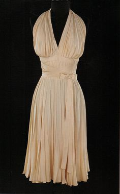 "This is the original dress worn by Marilyn in ""The Seven Year Itch"" . The fabric is more of a bone colour than white. Debbie Reynolds bought this dress after filming and sadly had to sell her collection of film memorabilia last year. This dress sold for $4,600,000 at auction."