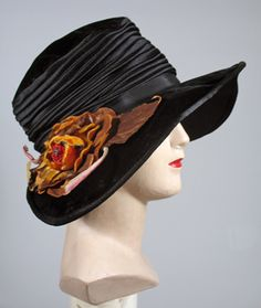Dramatic 1920s Black Velvet and Satin Wide Brimmed Cloche from early flapper era