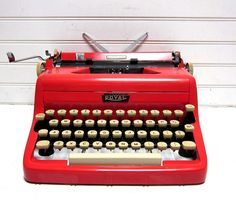 Royal typewriter...mine was pink and it was a highschool graduation present!