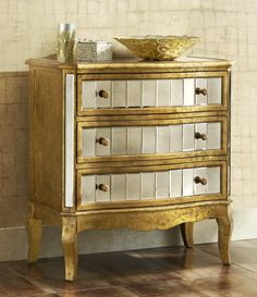 Pier 1 Crisanto Hall Chest is covered in shimmery golden color