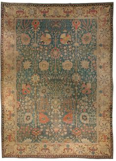 An Indian carpet BB3063 - by Doris Leslie Blau - An early 20th century Indian carpet, the green field with a large-scale overall design of palmettes and flowering ...