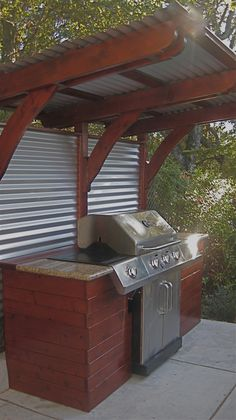 Restoration wood panels and corrugated metal siding, for patio/BBQ area www.picapainting.com