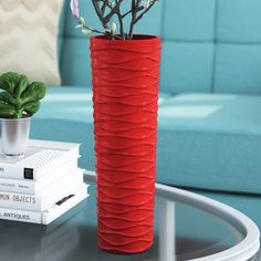 This beautiful vase will add a bright pop of color to your living room, kitchen, bedroom or office. Painted wood is a practical material that is shatter-proof should it fall. The undulating wave pattern and tall circular shape adds interest and timeless style. This piece also makes a wonderful gift for birthdays, weddings, anniversaries or housewarmings.