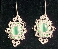 Light Green       Here is a pair of Tatsmithed earrings, using light green cats-eyes cabochons.
