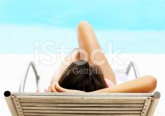 View of woman relaxing on a recliner by the pool royalty-free stock photo Healthy Skin Care, Rear View, Royalty Free Stock Photos, Relax, Skincare Routine, Vacation, Recliner, Pools, Travel