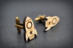 "Maple wood rocket cufflinks inspired by the romantic Frank Sinatra song ""Fly Me To The Moon"" These cufflinks are made with a thin slab of Flamed Maple from Fiemme Valley (Italy) usually used to build high-quality violins and basses. Beautifully laser engraved and cut they are hand finished using natural products such as beeswax, sea sand and other secrets learned from the experts luthiers in Cremona."