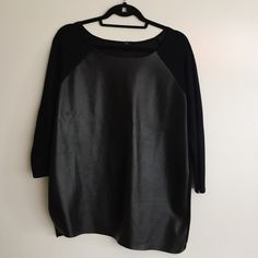 Mixed media black top Mixed media black top. Faux leather is on the front, knit sleeves and back. Uneven hem. Very trendy. Sweaters Crew & Scoop Necks