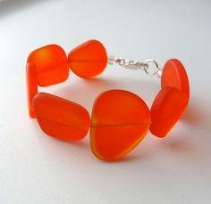 Tangerine Orange Sea Glass Bracelet by cjsseashop on Etsy - all her jewelry is so pretty!