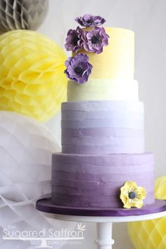 Ombre purple and yellow cake with anemones.
