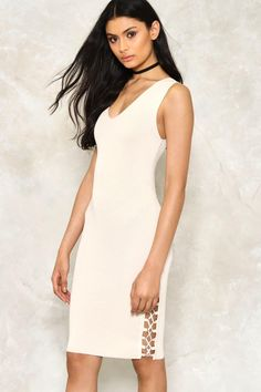 Give me a ring. This dress comes in a ribbed knit and features a slight V-neckline, midi, bodycon silhouette, and lace-up detailing with D-rings at sides.