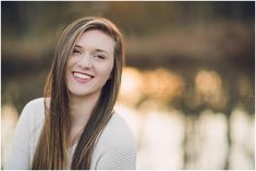 Love this senior portrait with the sunset glow reflecting on the pond!