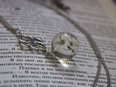 #boho #pendant orb made of crystal eco-resin with with real #dandelion seeds.  *Price 25 USD*  #resinjewelry