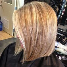 Cute mid length angled bob..