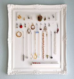 Organize your jewelry and decorate your room with this framed board.